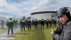Dutch Veterans are sprayed with water cannons but standing their ground